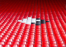 Empty seats red around white and black. Royalty Free Stock Photo