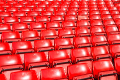 Empty seats red at outdoor stadium. Stock Photo