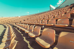 Empty seats at soccer stadium , vintage Royalty Free Stock Photography