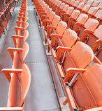 Empty seats  before the sporting event. Many empty seats in the stands before the sporting event Royalty Free Stock Images
