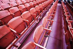 Empty seats  before the sporting event. Many empty seats in the stands before the sporting event Stock Image