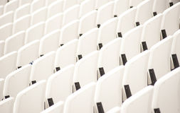 Empty seats at the stadium. White empty seats in the stadium Royalty Free Stock Photo