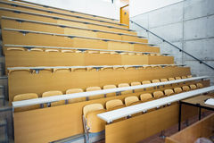 Empty seats with tables in a lecture hall Stock Images