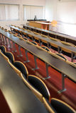 Empty seats with tables in a lecture hall Royalty Free Stock Photo
