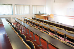 Empty seats with tables in a lecture hall Royalty Free Stock Images
