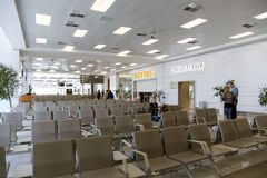 Empty seats in terminal waiting room in airport Stock Photos