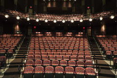 Empty Seats in Theater. Rows of empty seats in theater seen from stage. Horizontal shot Royalty Free Stock Photography