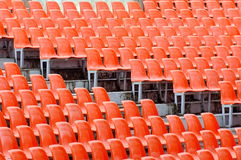 Empty seats. Tribune with orange chairs Stock Photo