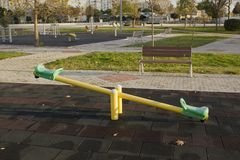Empty seesaw in park photo. Very high detailed photo of an empty seesaw standing in a park photo Stock Image