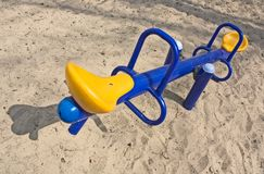 An empty seesaw in a playground Royalty Free Stock Images