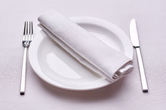 Empty served restaurant table with white tablecloth. Dinner time. business lunch Royalty Free Stock Images