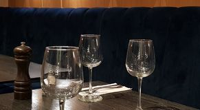 Three empty wine glasses on a table stock photo
