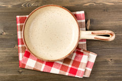 Empty serving ceramic pan on wooden table Stock Photo