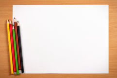 Empty sheet and color pencils on desk, art concept Stock Image