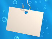 Empty sheet of a paper, hanging on a fishing hook Stock Images