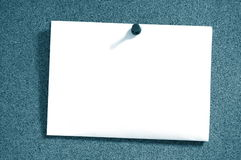 Empty sheet paper with push pin. Blank and empty sheet of paper with copyspace for text message Royalty Free Stock Image