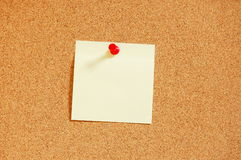 Empty sheet paper with push pin. Blank and empty sheet of paper with copyspace for text message Royalty Free Stock Photo