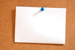 Empty sheet paper with push pin. Blank and empty sheet of paper with copyspace for text message Royalty Free Stock Photography