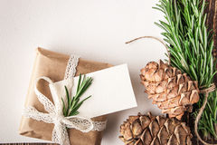Empty sheet of paper with rosemary , cones and present Royalty Free Stock Image