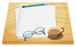 Empty sheets of paper above the wooden table Stock Photo