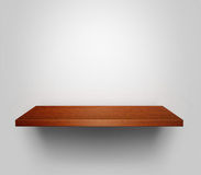 Empty shelf. Empty wooden shelf with copy space hanging at the wall Stock Images