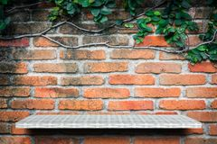 Empty shelf on brick garden wall background for product display royalty free stock photos