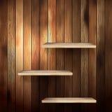Empty shelf for exhibit on wood background. EPS 10 Stock Images