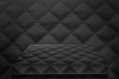 Empty shelf on leather wall. Background Stock Image