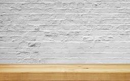 Empty shelf on white brick wall