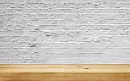 Empty shelf on white brick wall Stock Images