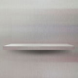 Empty shelf. Empty white shelves against the wall Royalty Free Stock Photography