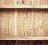 Empty shelf on wooden background Royalty Free Stock Photos