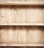 Empty shelf on wooden background. Stock Images