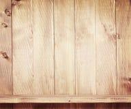 Empty shelf on wooden background. Stock Photos