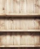 Empty shelf on wooden background. Stock Photography