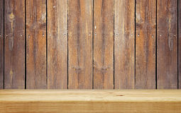 Empty shelf on wooden plank wall Stock Photography