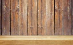 Empty shelf on wooden plank wall Stock Photography