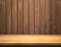 Empty shelf on wooden plank wall Stock Photo