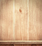 Empty shelf on wooden wall Stock Photography