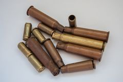 Empty shells from live ammunition to machine gun and pistol stock images