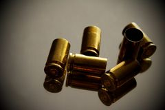 Empty shells. Six empty bronze gun shells on the mirror Royalty Free Stock Images