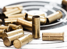 Empty shells of small-bore rifle Stock Photos