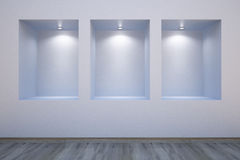 Empty shelves. In a wall-honored spotlights Royalty Free Stock Image