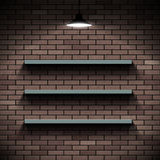 Empty shelves on a background of a brick wall. Illuminated by la Stock Photography