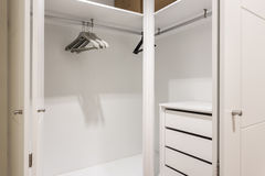 Empty shelves in the closet wardrobe for clothes. Stock Photo