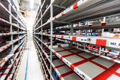 Interior of hardware shop storage. Empty shelves in house appliances store warehouse Royalty Free Stock Photos