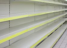 Empty shelves in  shop Stock Images