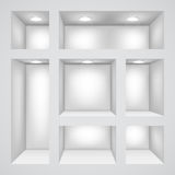 Empty shelves. White wall with empty shelves for exhibition Stock Image
