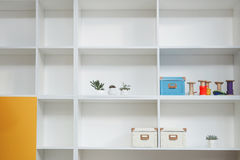 Empty shelves in white wooden rack Stock Photography
