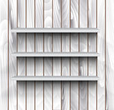 Empty shelves on the wooden wall Stock Image